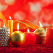 Christmas card candles red and golden in a row - Foto Stock