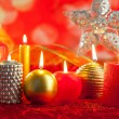 Christmas card candles red and golden in a row — Stock Photo