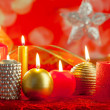 Christmas card candles red and golden in a row — Stock Photo #7497674