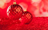 Christmas card of red capiton bauble — Stock Photo