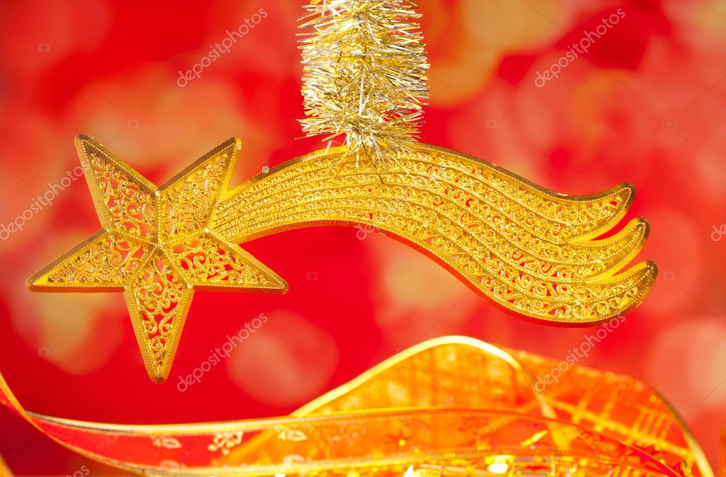 Christmas card bethlehem comet gold star on red blur background — Stock Photo #7497634