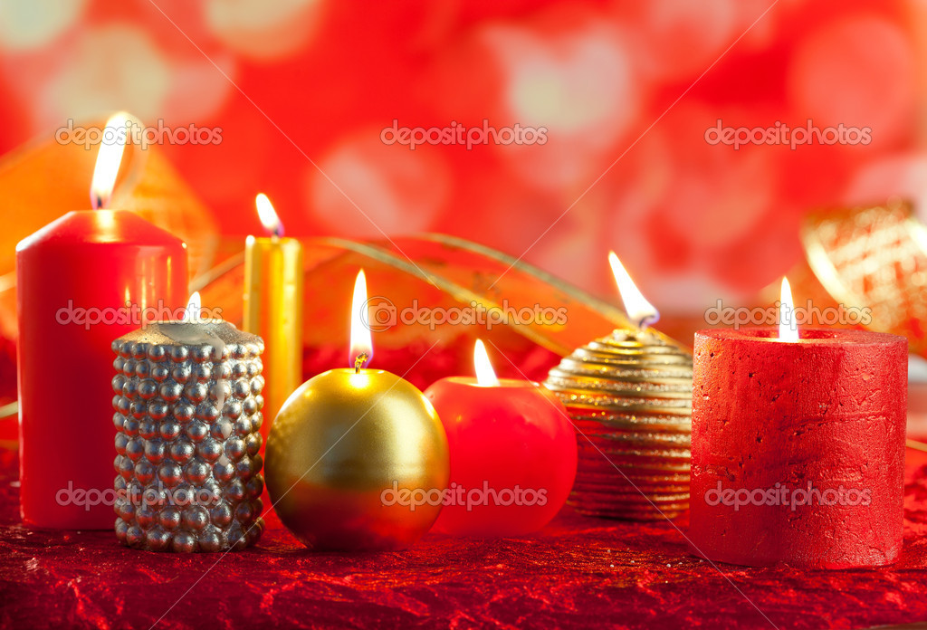 Christmas card candles red and golden in a row on blurred background  Stock Photo #7497653