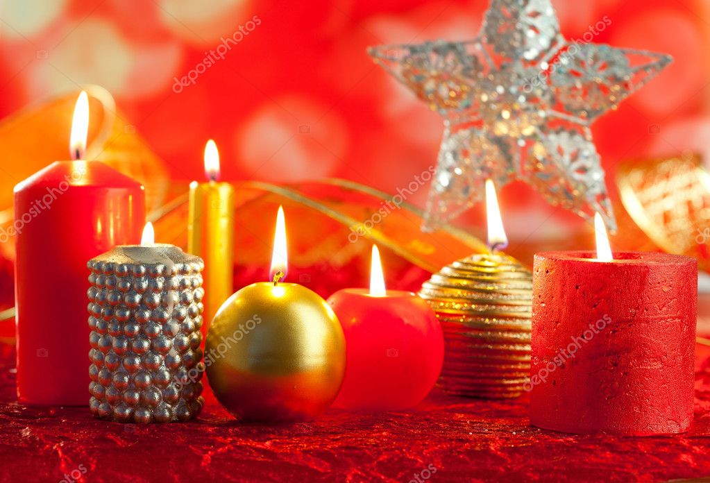 Christmas card candles red and golden in a row on blurred background  Stock Photo #7497663