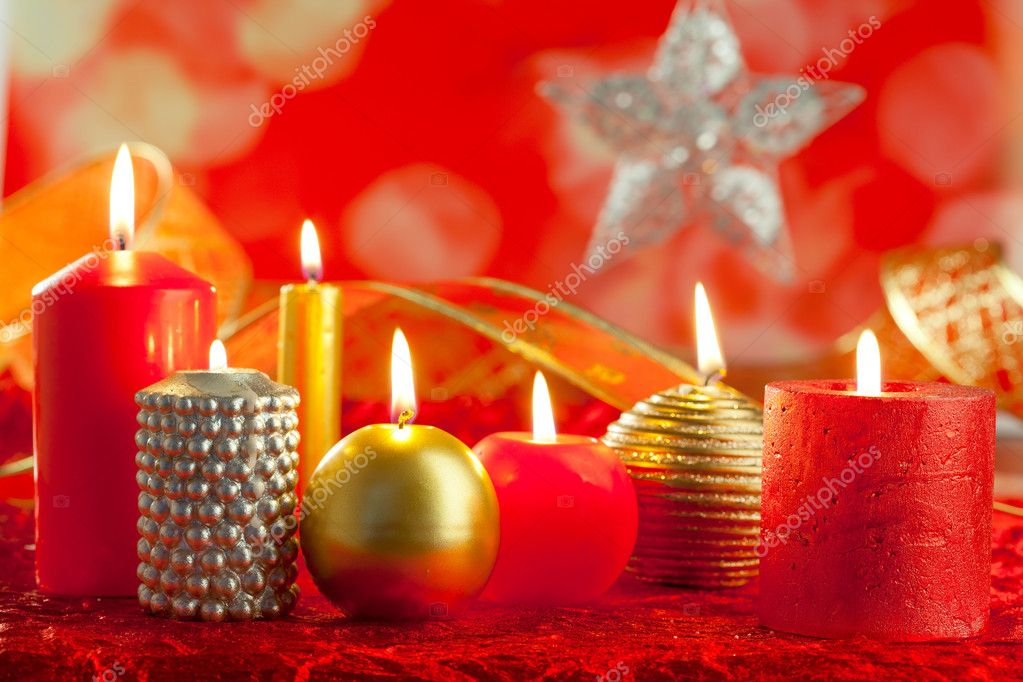 Christmas card candles red and golden in a row on blurred background  Stock Photo #7497674