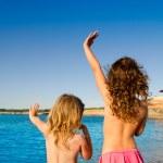 Ibiza Cala Conta little girls greeting hand sign — Stock Photo