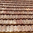 Clay flat roof tiles weathered in Ibiza - Stock Photo