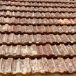Clay flat roof tiles weathered in Ibiza — Stock Photo