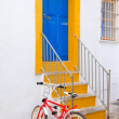 Ibiza white facade in blue door stairs — Stock Photo