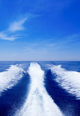 Boat wake prop wash on blue ocean sea — Stock Photo