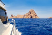 Ibiza yacht reaching Es Vedra island — Stock Photo