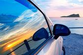 Ibiza cala Conta Conmte in window car glass — Stock Photo