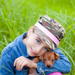 Little girl with pet puppy mascot mini pinscher — Stock Photo