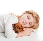 Blond kid girl with mini pinscher pet mascot dog — Stock Photo