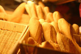 Bread basket in golden warm color — Stock Photo