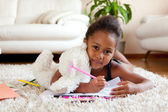 Little African Asian girl drawing — Stok fotoğraf