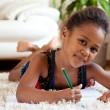 Little African Asian girl drawing — Stock Photo #6943434