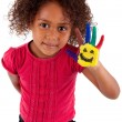Little African Asian girl with painted hands - Stock Photo