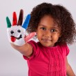 Little African Asian girl with painted hands — Stock Photo #7119238