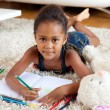 Little African Asian girl drawing — Stock Photo #7152111