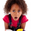 Little African Asian girl with painted hands — Stock Photo