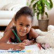 Little African Asian girl  drawing - Stock Photo