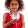 Cute little African Asian girl drinking milk — Stock Photo #7214138