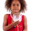 Cute little African Asian girl drinking milk — Stock Photo