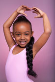Cute little African American girl dancing — Stock Photo