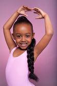 Cute little African American girl dancing — Stock Photo