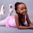 Cute little African American girl wearing a ballet costume — Stock Photo