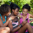 Teenage black girls using a phone, — Stock Photo