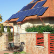 Stock Photo: Solar power photovoltaic energy panels on tiled house roof