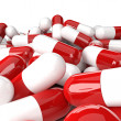Heap of red-white capsules — Stock Photo