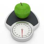 Scales and apple on a white background. — Stock Photo
