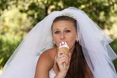 Bride with ice cream — Stock Photo
