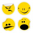 Set of yellow labels with smiles - Stok Vektör