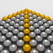 Grey 3D balls with gold ones forming an arrow - Stock Photo