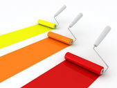 Paint rollers with paint on white background — Stock Photo