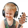 Photo: Little boy with headphones and guitar
