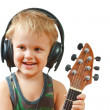 Little boy with headphones and guitar - Stock Photo