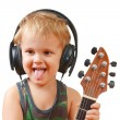 Little boy with headphones and guitar — Stock Photo #6749071