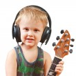 Little boy with headphones and guitar — Stock Photo #6749091