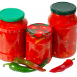 Home canned vegetables in jars and peppers — Stock Photo