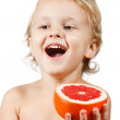 Stock Photo: Little boy with a pink grapefruit