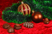 New Year's still life of chocolate on a red velvet — Stok fotoğraf