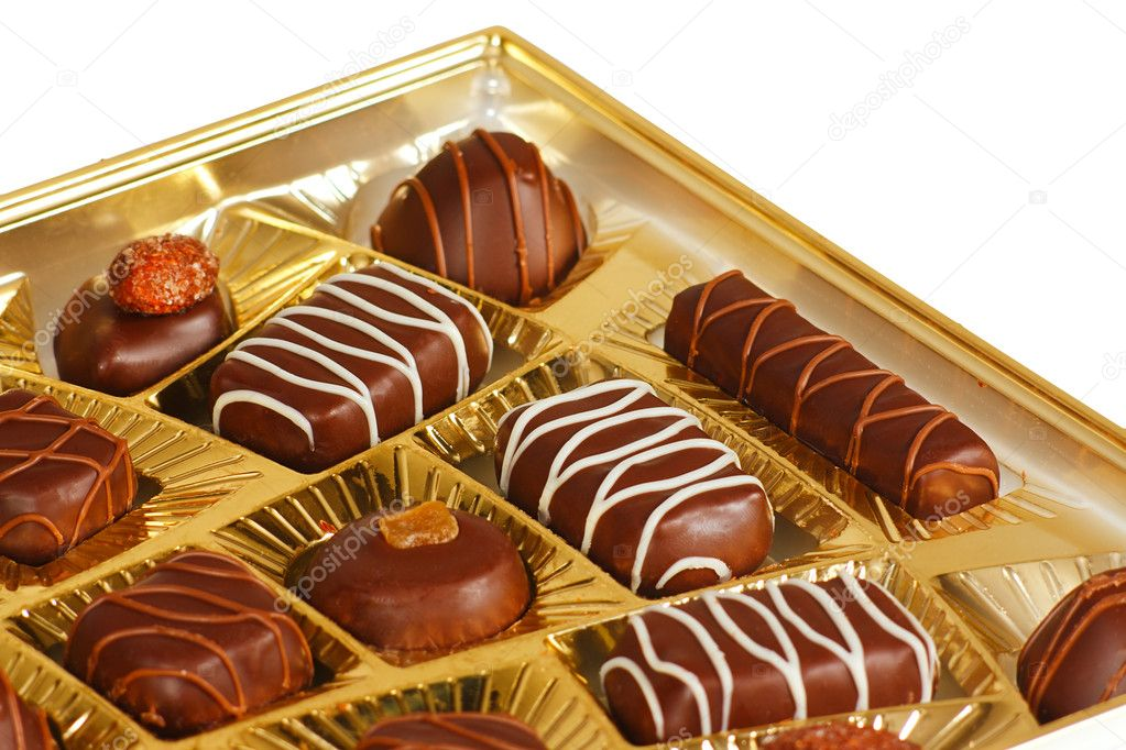 Sweets from a black and white chocolate in a box — Stock Photo #7413801