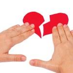 Hands combine broken red heart — Stock Photo