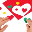 Hands combine red and green hearts — Stock Photo