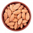 Ceramic bowl full of almonds isolated on white — Stock Photo
