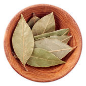 Dry bay leaf in a wooden bowl isolated on white — Stock Photo
